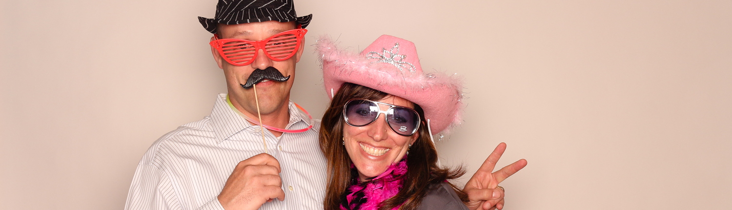 Photobooth fun with glasses, mustache and pink cowboy hat