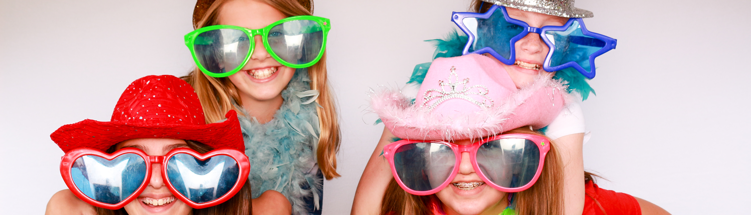 Photobooth prop fun with glasses and hats, piggy back