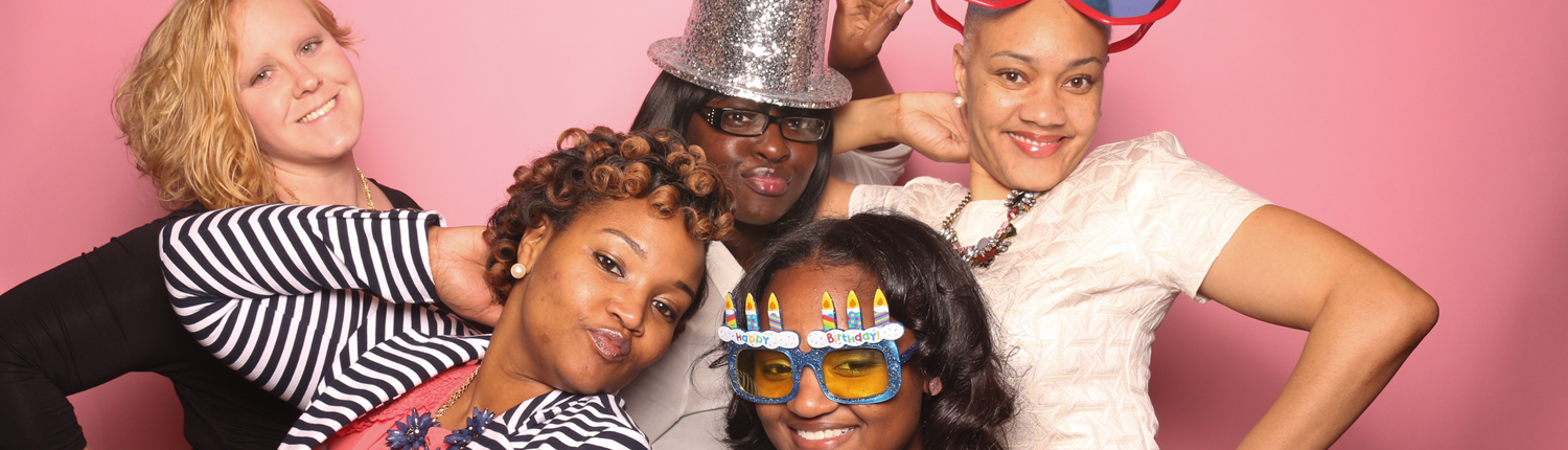 Photobooth fun with glasses, hat, and sweet 16 glasses